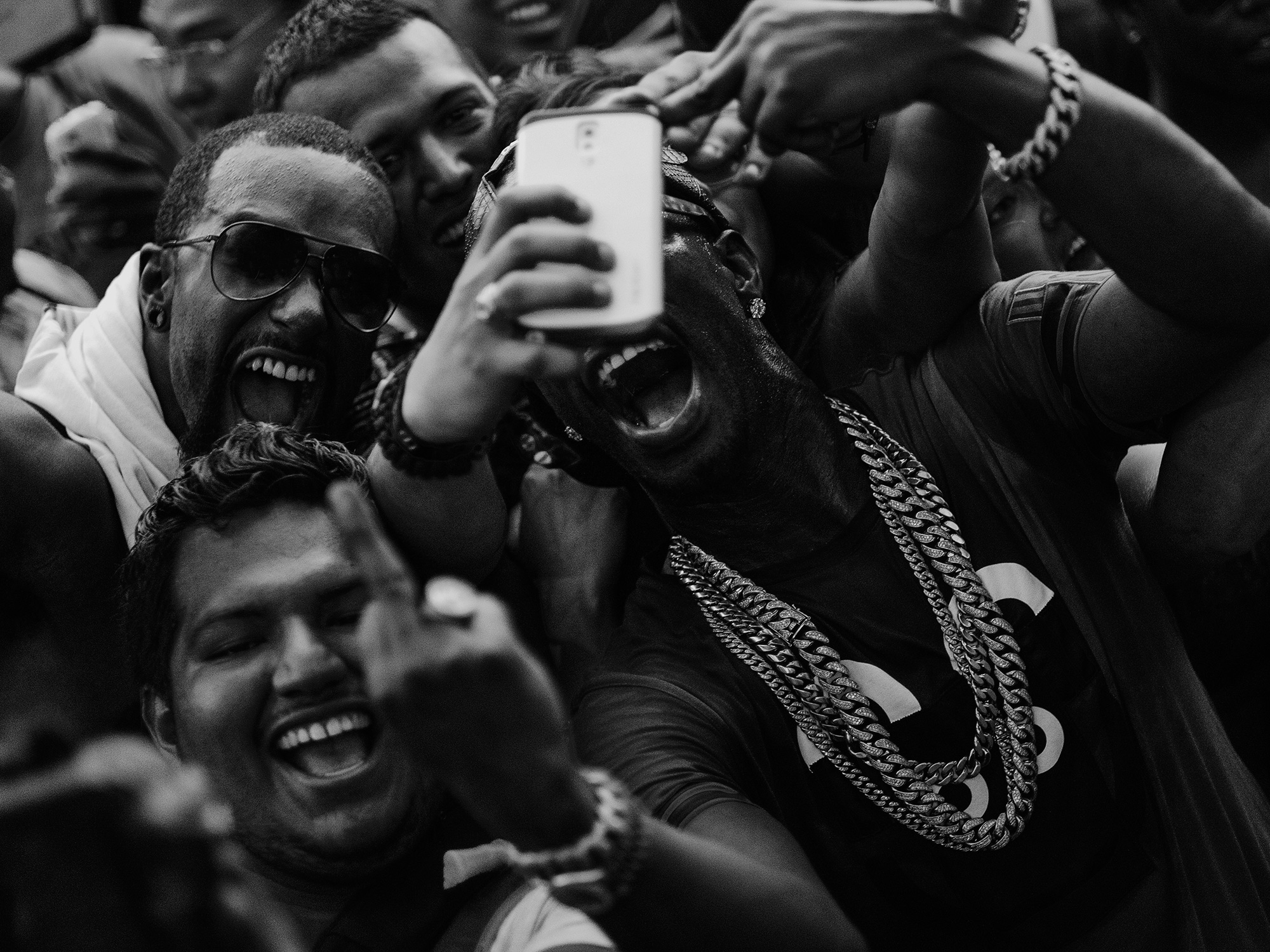 Juicy J, hip hop artist, producer rapper and part of the outfit, Three Six Mafia, parties with an enthusiastic crowd in Houston, Texas, photographed by Todd Spoth.