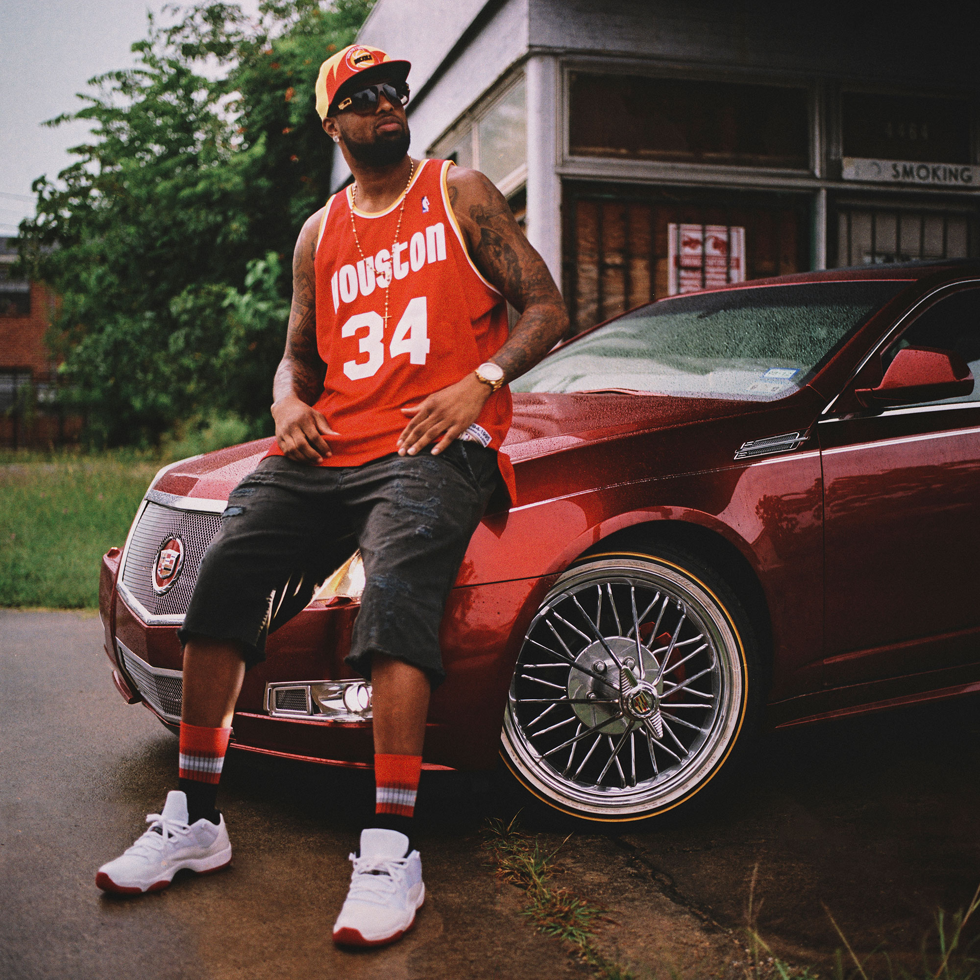 Slim Thug, hip hop artist, is photographed with one of his slabs near MacGregor Park in Houston, Texas, by Houston editorial and commercial photographer, Todd Spoth.
