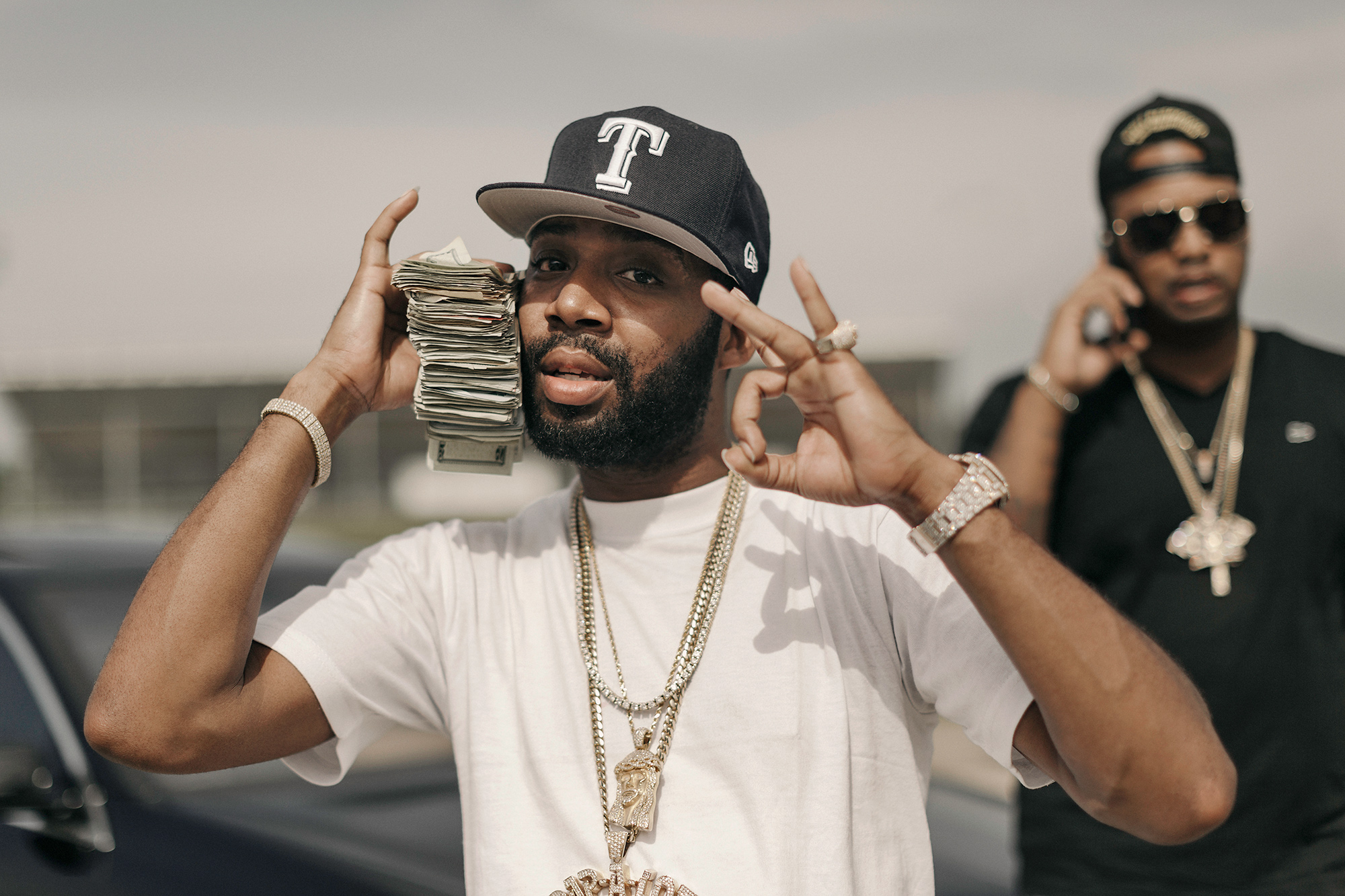 J Prince Jr. holds up a stack of money on the set of a music video in Houston, Texas, photographed by music photographer Todd Spoth.