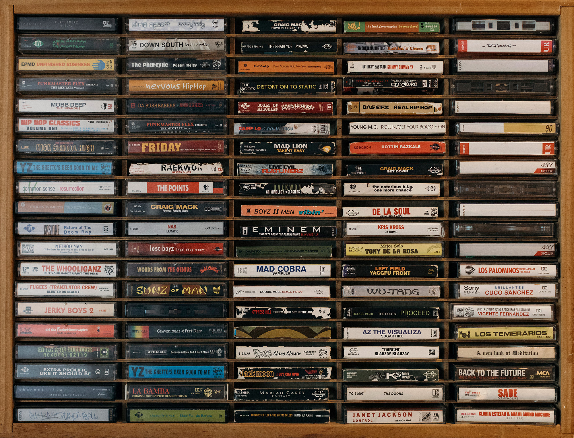 A vintage cassette tape rack filled with the carefully curated gems of El Dusty as photographed by music photographer, Todd Spoth, in Corpus Christi, Texas.