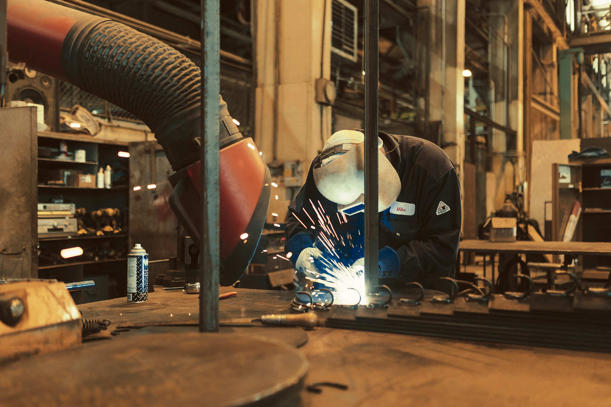 An Exxon Mobil employee welds in the shop on location in Beaumont, Texas photographed by photographer, Todd Spoth.