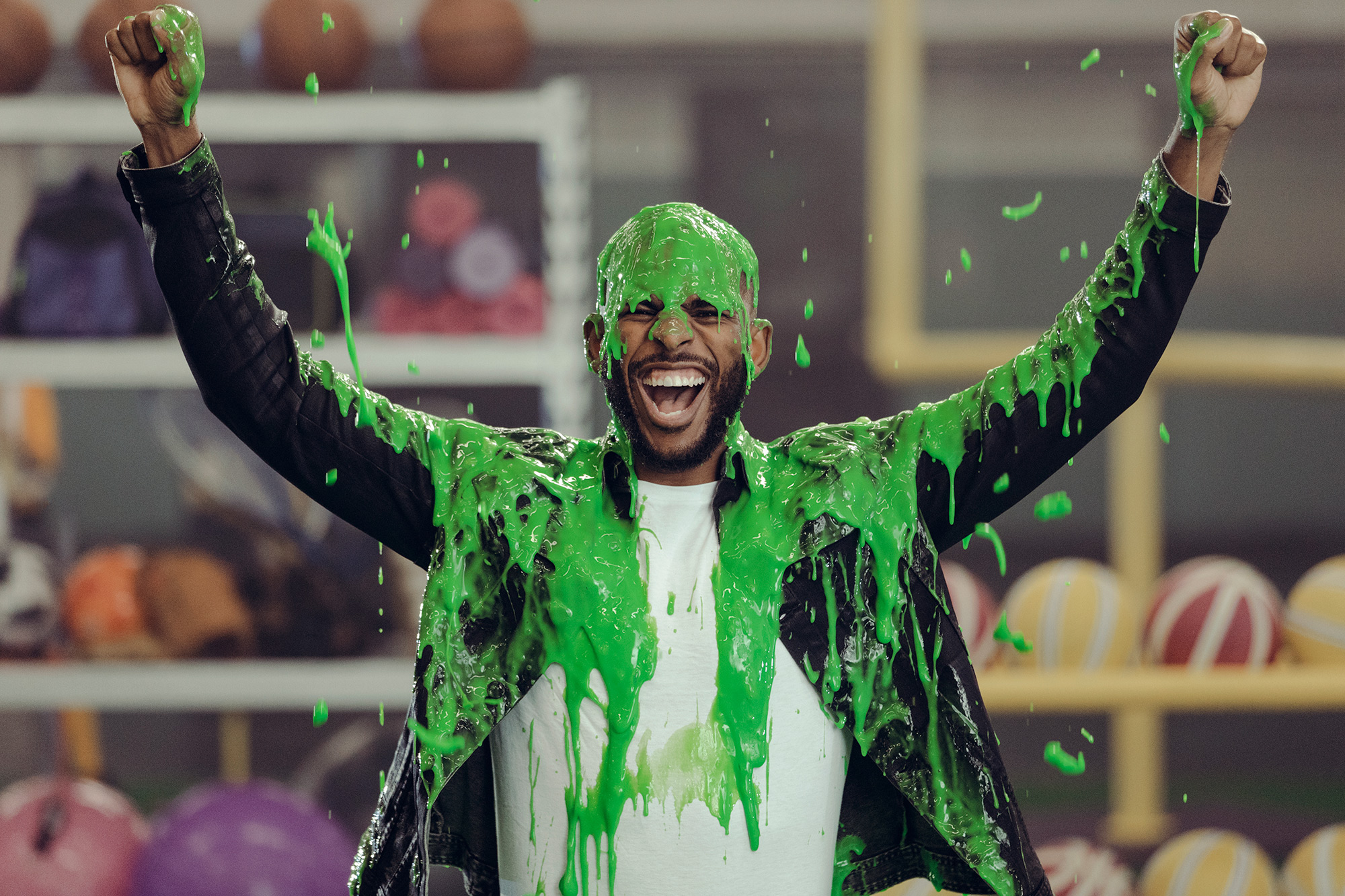 Chris Paul, NBA superstar is slimed during the filming of a commercial spot for Nickelodeon in Houston, Texas, photographed by commercial photographer, Todd Spoth.