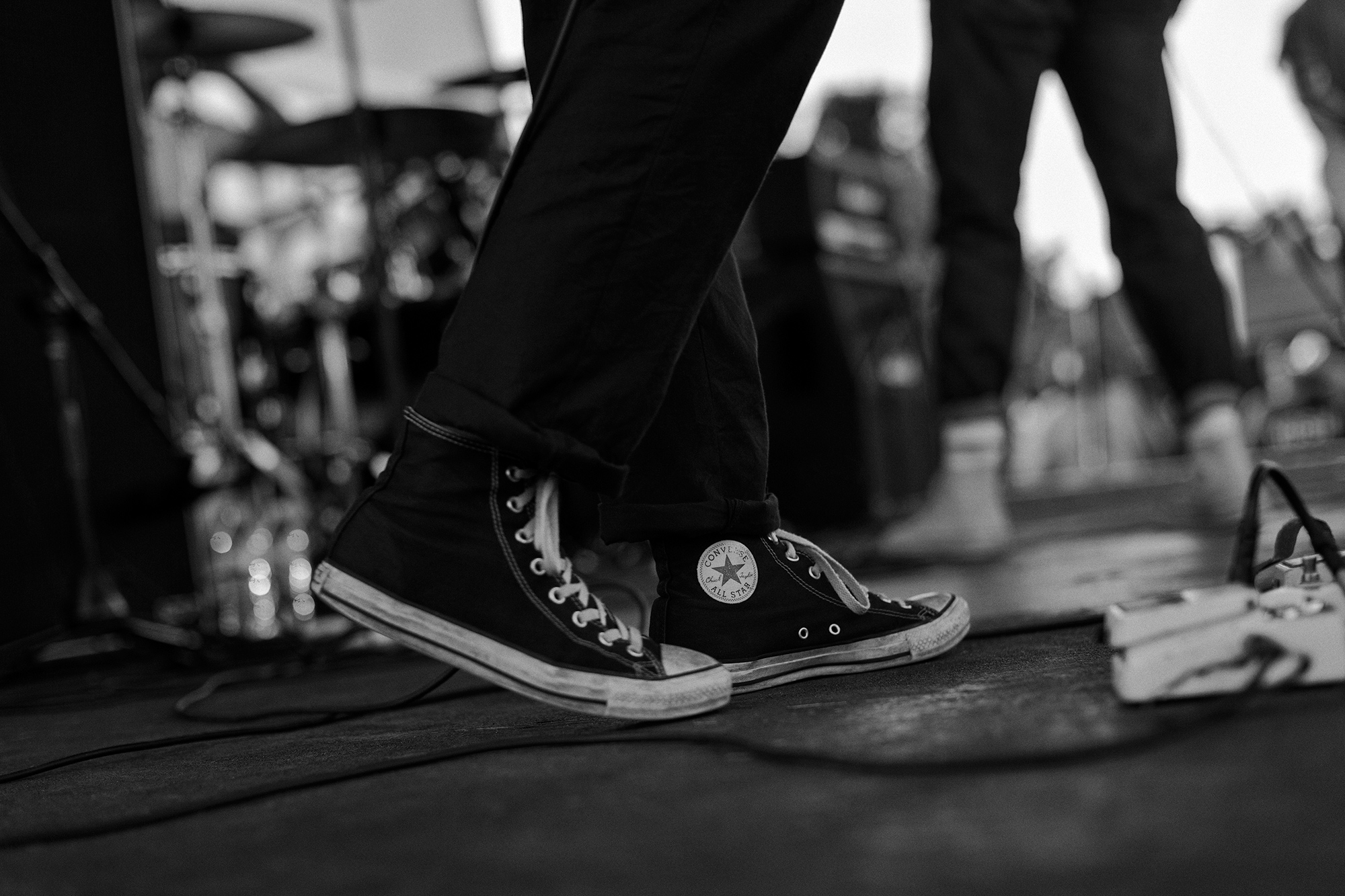 A pair of classic Converse Chuck Taylors on stage in Houston, Texas, photographed by Todd Spoth.