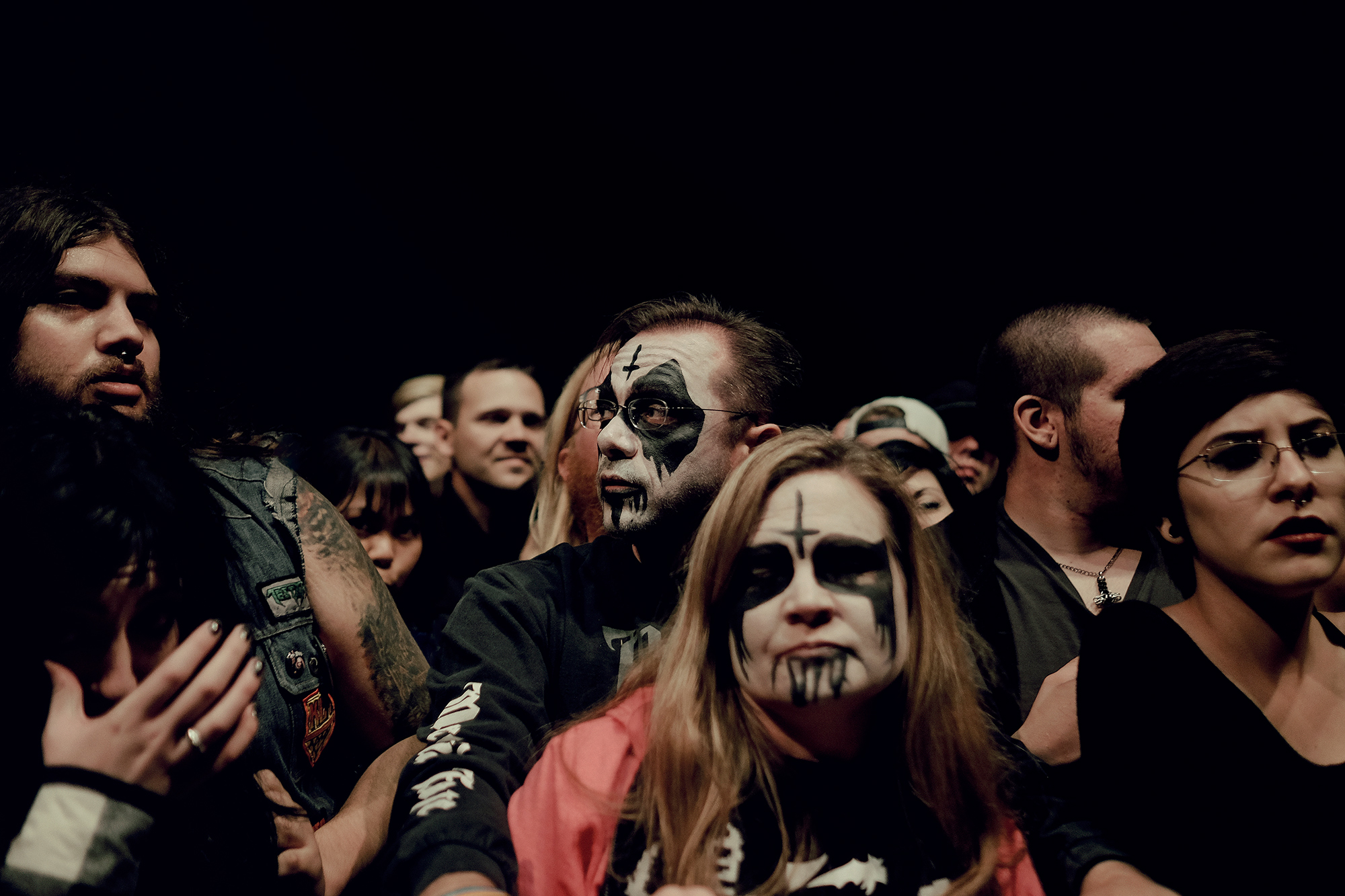 Metalhead parents at the metal show, photographed by music photographer, Todd Spoth.