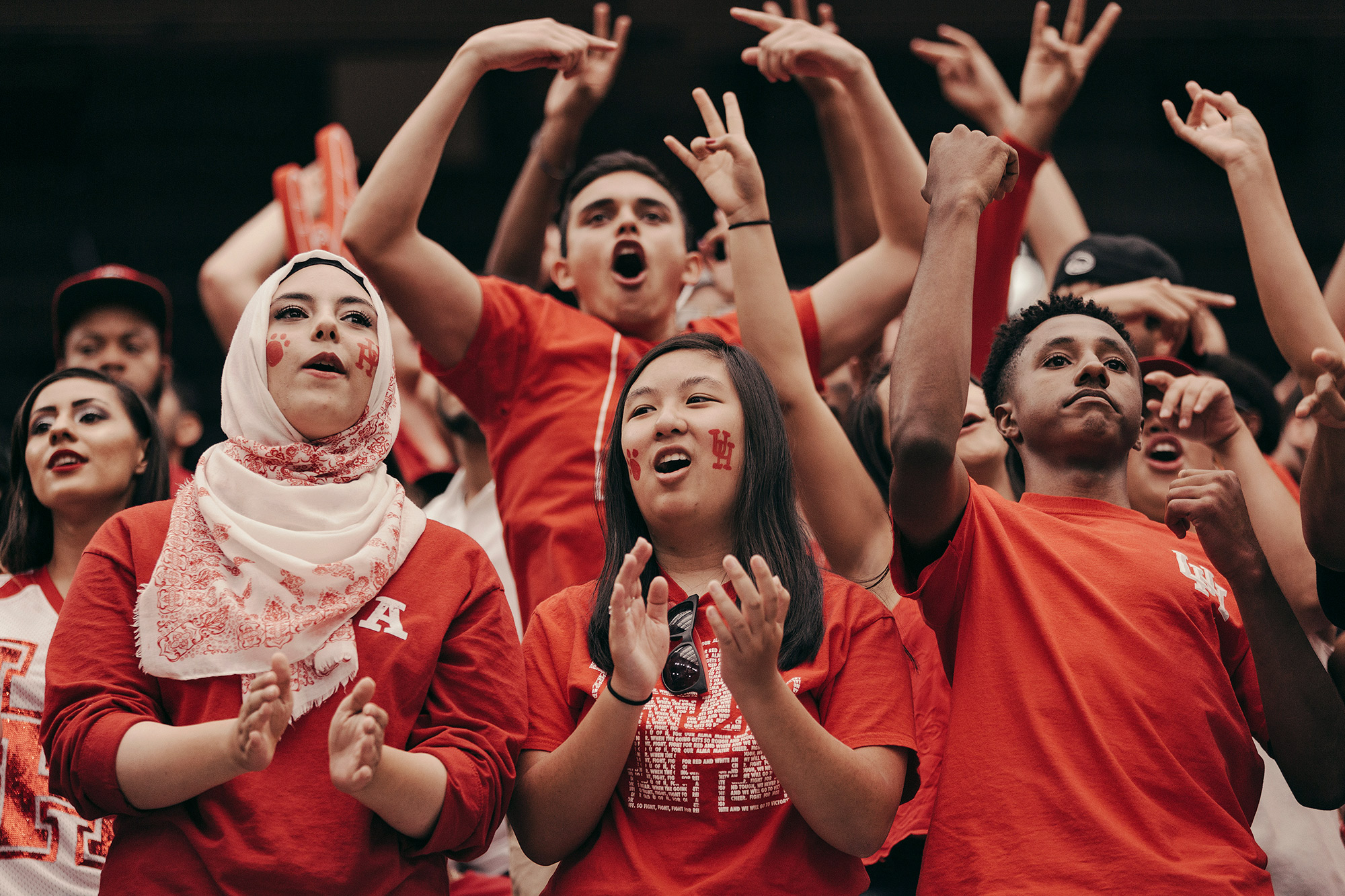 The student section at a University of Houston football game at TDECU stadium in Houston, Texas, photographed by editorial and commercial photographer, Todd Spoth.