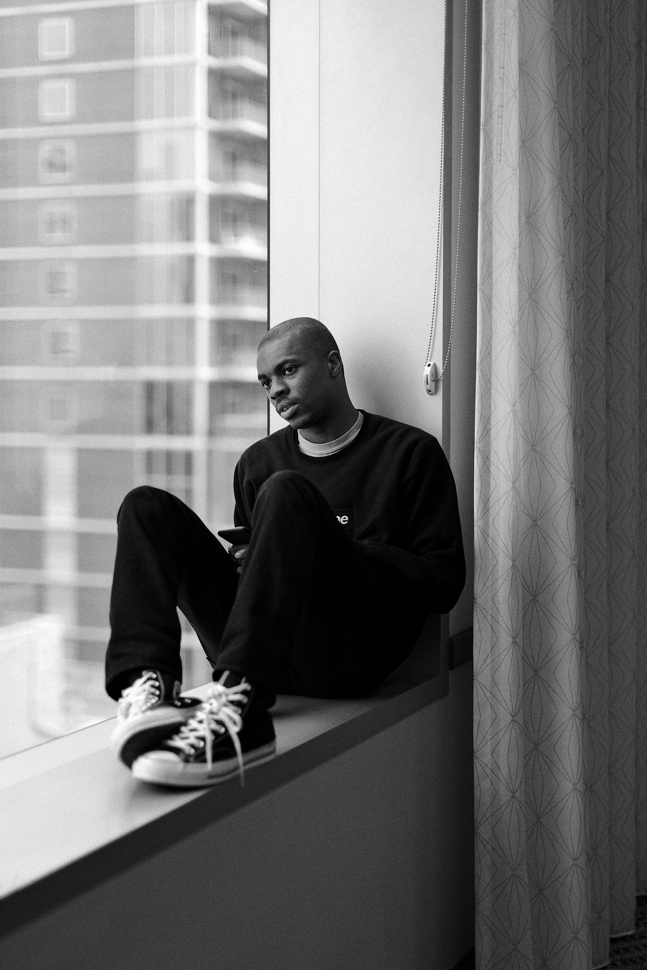 Vince Staples, hip hop artist, takes a break backstage during the South by Southwest music festival in Austin, Texas, photographed for Billboard Magazine by Todd Spoth.