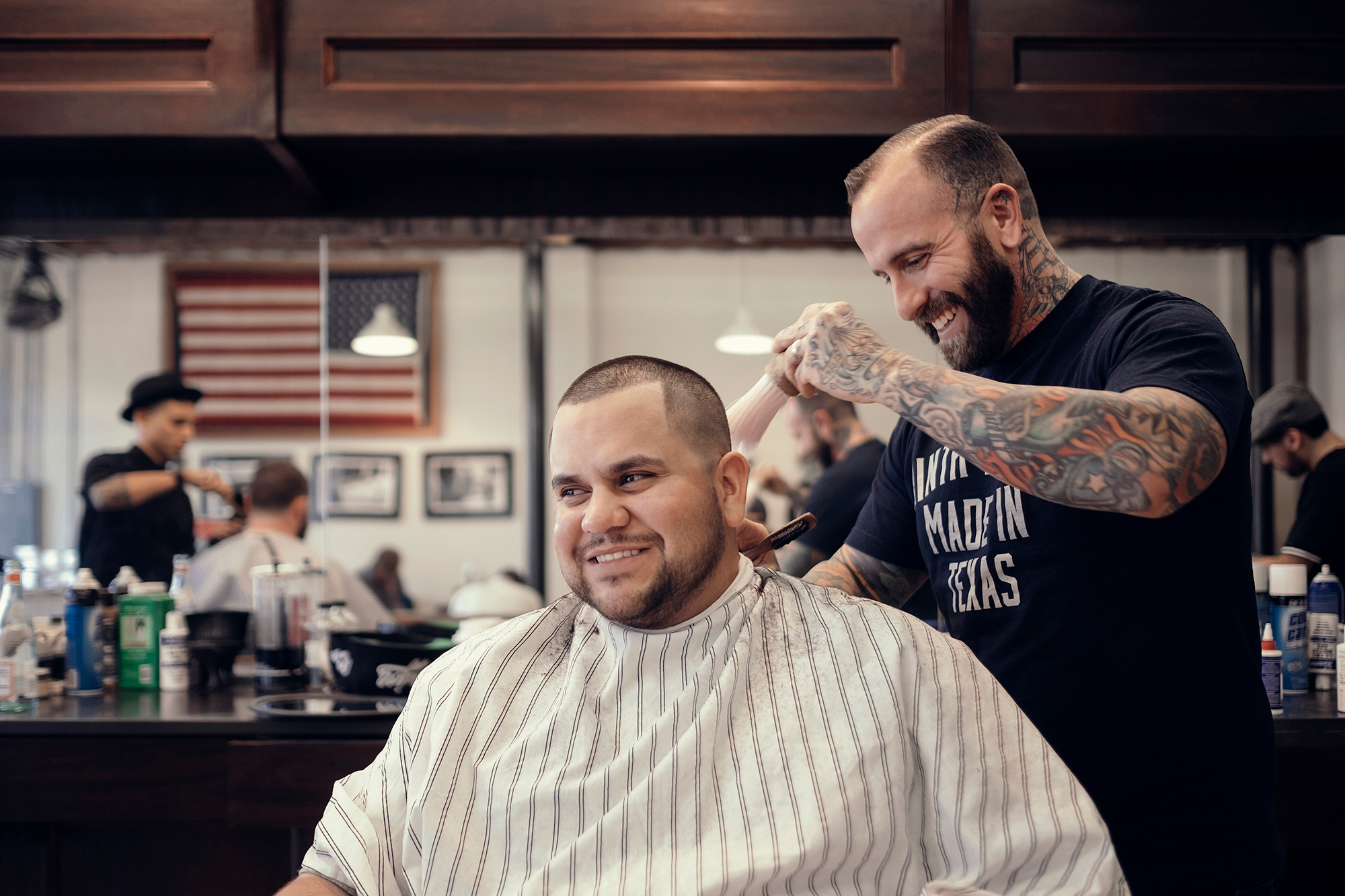 Ryan Chase Taylor, barber and owner of East End Barber, photographed at work by Houston photographer, Todd Spoth.