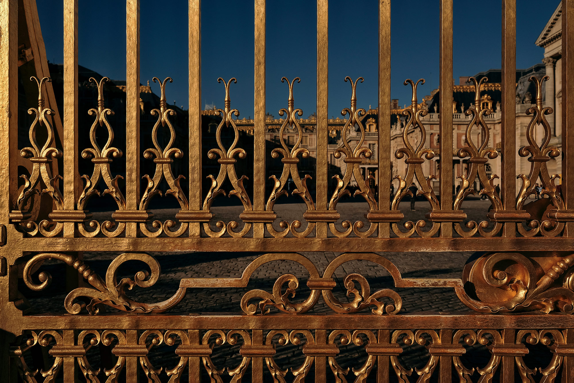 The gold-gilded gates of Versailles outside of Paris, France, photographed by travel photographer, Todd Spoth.