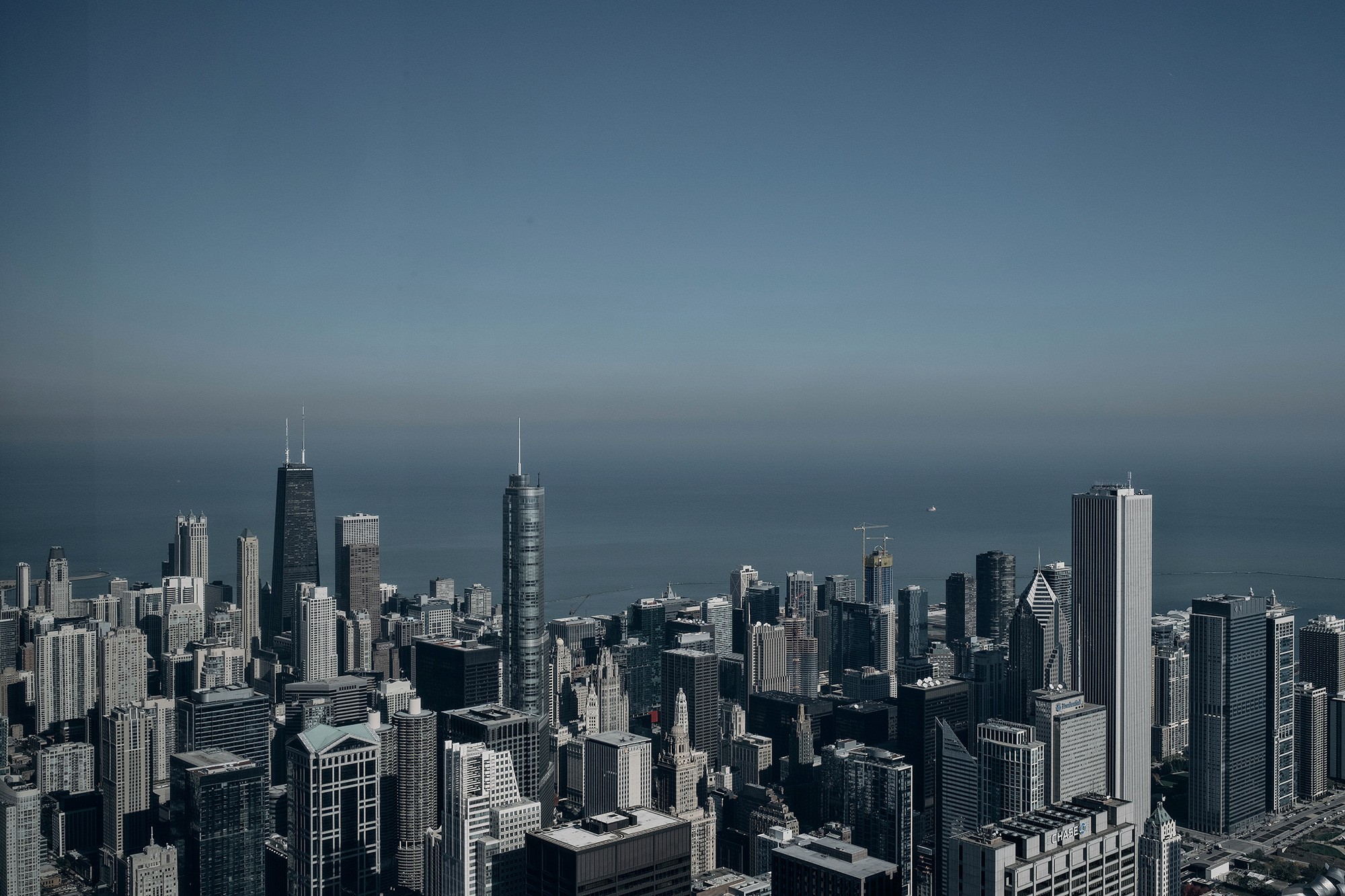 A view of the skyline of Chicago, Illinois as taken from the Sears Tower in downtown Chicago by photographer, Todd Spoth.