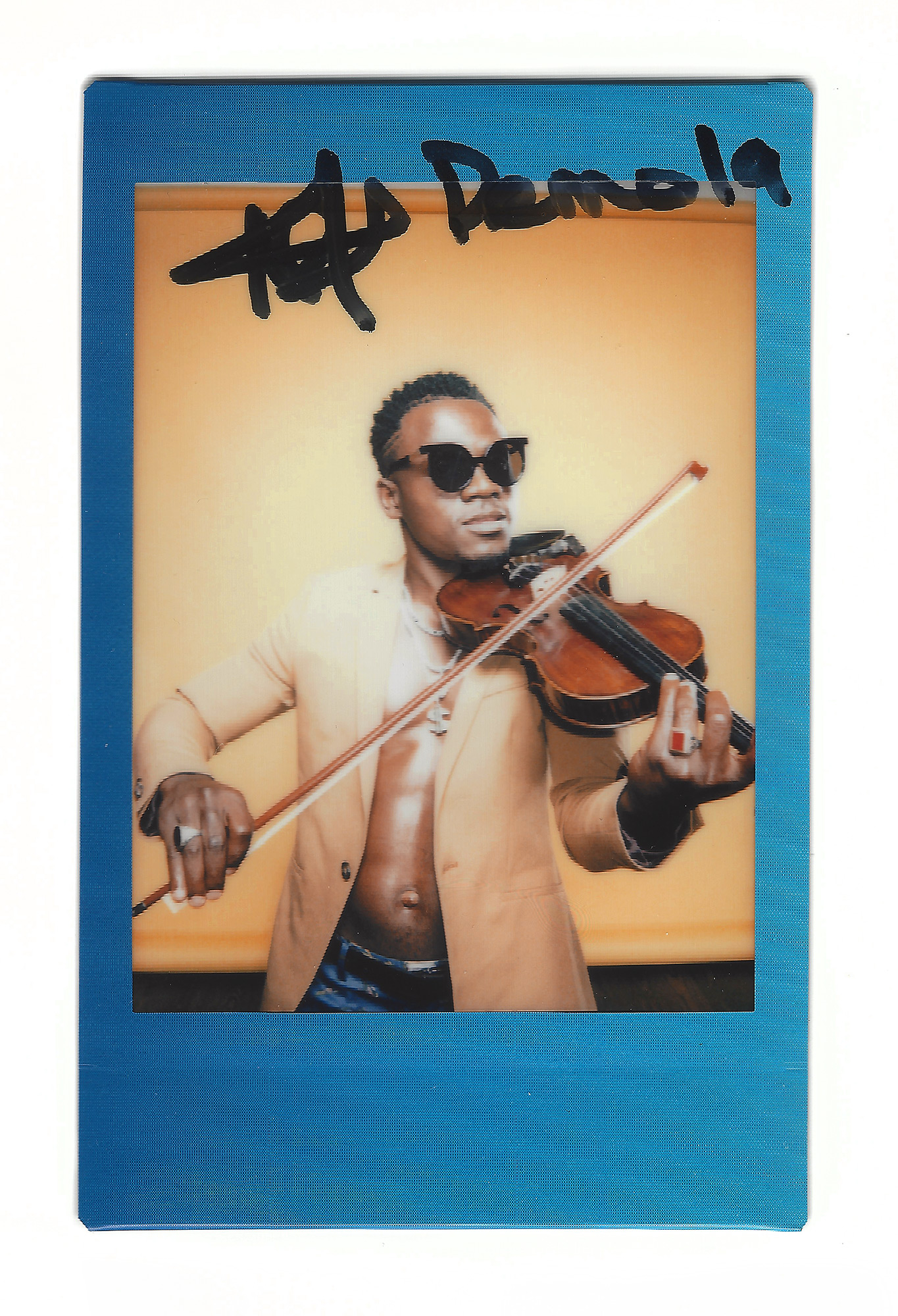 Demola, African violinist and hip hop artist, photographed in the Todd Spoth Photography studios in Houston, Texas by editorial and commercial photographer, Todd Spoth.