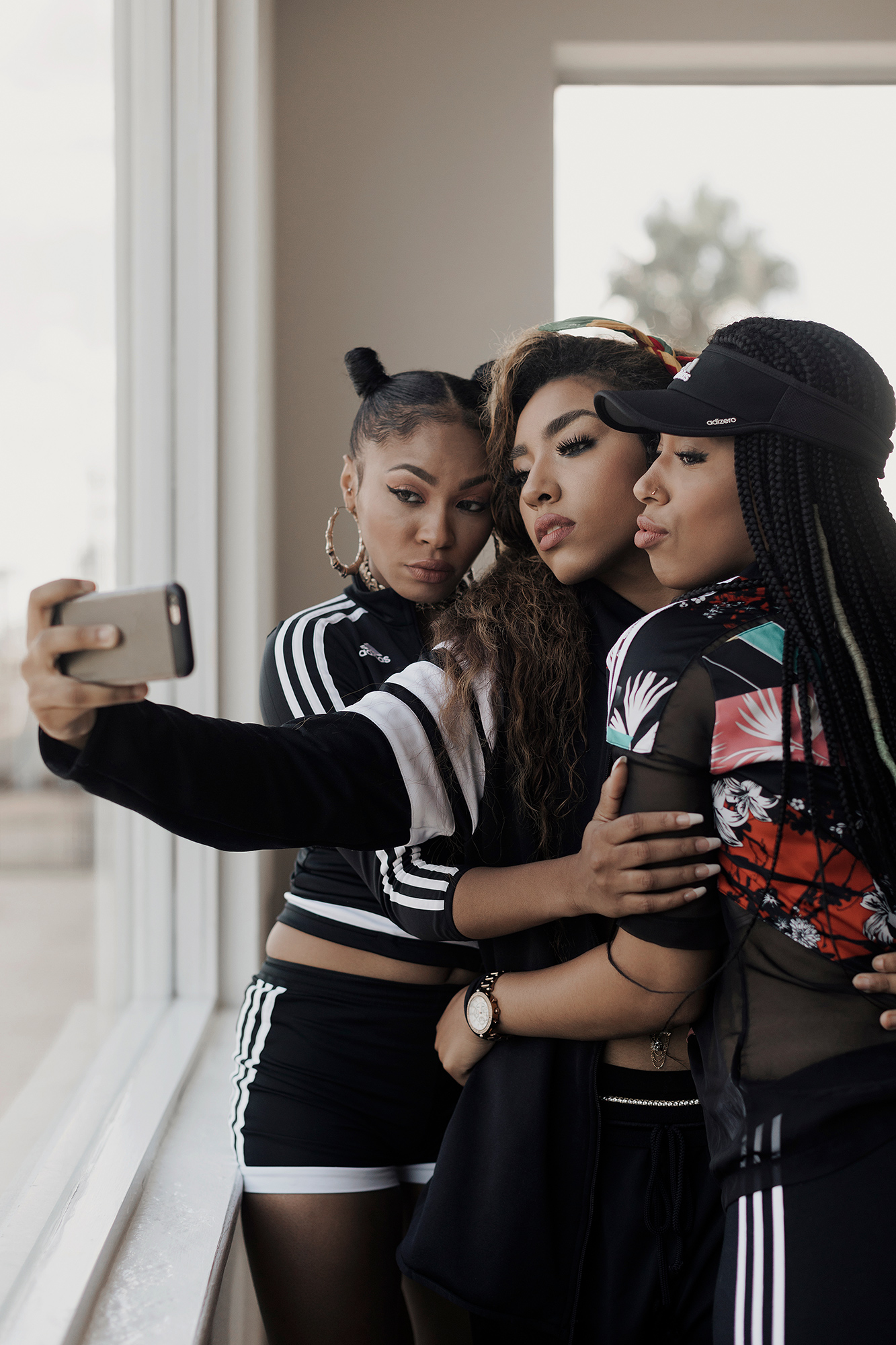 Blushhh Music, Music World Entertainment r&b and hip hop group, takes a selfie at the Music World Entertainment offices in midtown Houston, Texas, photographed by music photographer, Todd Spoth.