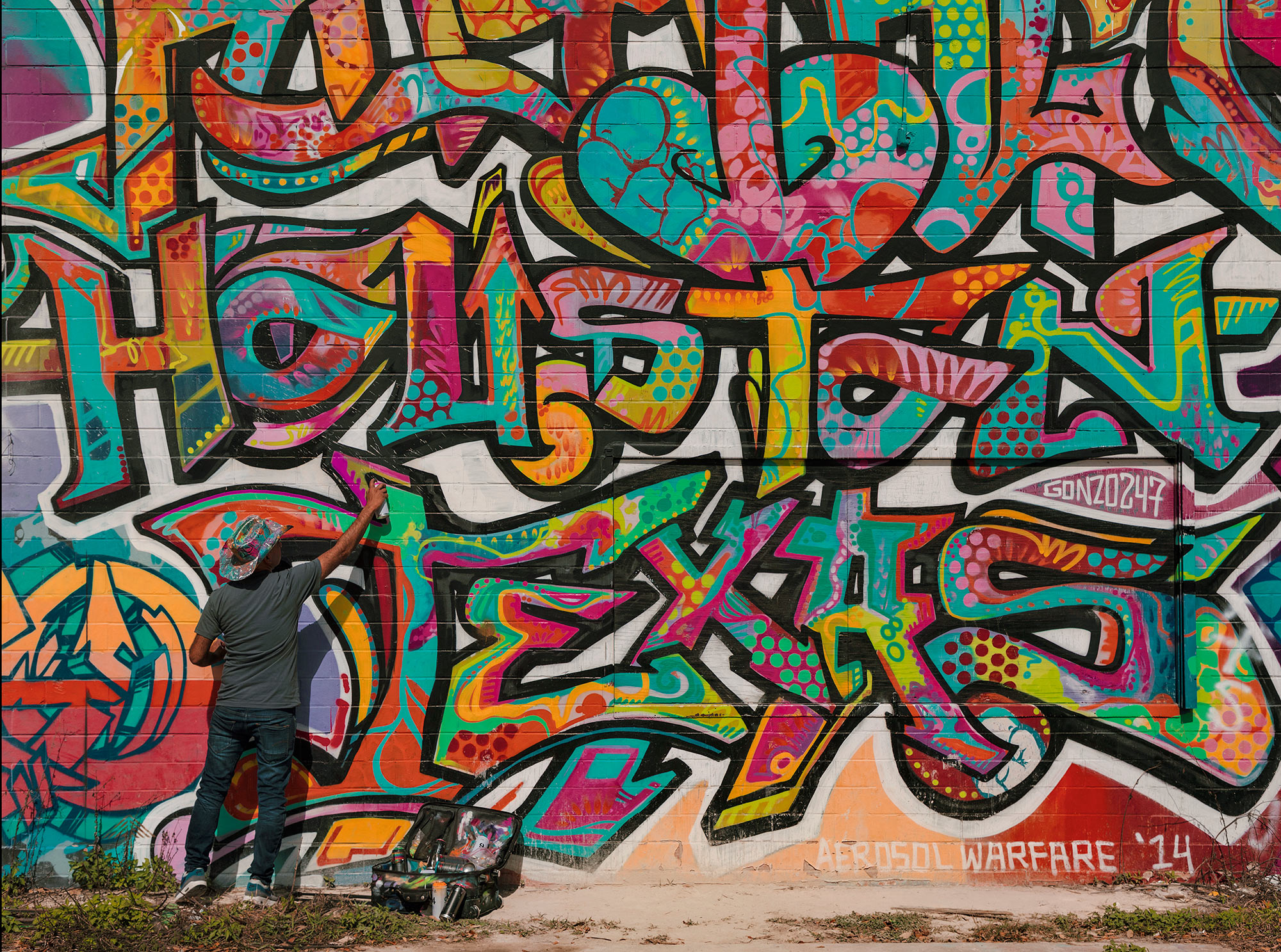 "Gonzo 247, Houston artist, works on his piece, ""Urban Rhythm Houston Texas"" started in 2014 in Houston, Texas, photographed by Texas editorial photographer, Todd Spoth."