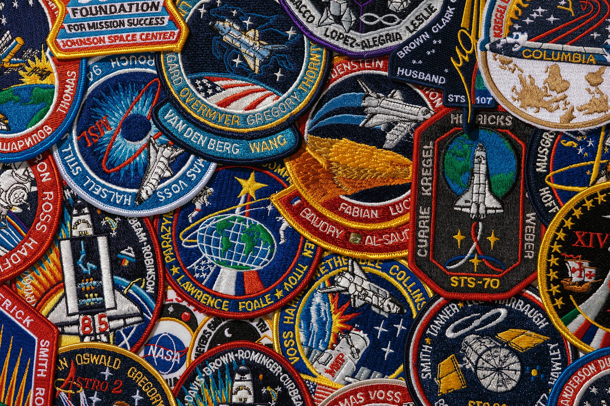 A grouping of space-flown official mission patches from past NASA space missions owned and photographed by Todd Spoth.